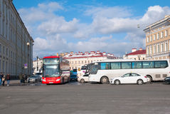Saint – Petersburg. Russia. Excursion buses near The Palace Square Stock Photos
