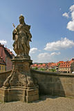 Saint. Religious Sculpture on a bridge in Bamberg Stock Images