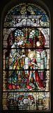 Saint Aloysius is given his first communion by Saint Charles Borromeo. Stained glass window in the church of Saint Martin in Zagreb, Croatia royalty free stock images