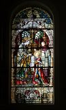 Saint Aloysius is given his first communion by Saint Charles Borromeo. Stained glass window in the church of Saint Martin in Zagreb, Croatia stock photos