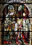 Saint Aloysius is given his first communion by Saint Charles Borromeo. Stained glass window in the church of Saint Martin in Zagreb, Croatia stock photo
