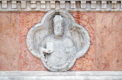 Saint Ambrose. By Giovanni di Riguzzo relief on facade of the San Petronio Basilica in Bologna, Italy Stock Photography