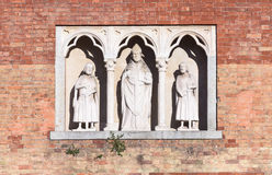 Saint Ambrose. In the picture three statues, located in the center the statue of Saint Ambrose, Milan, Italy Stock Images