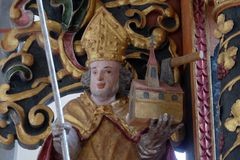 Saint Ambrose. Statue on the main altar in the chapel of St. Wolfgang in Vukovoj, Croatia Stock Image