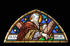Saint Andrew apostle. Stained glass church window Stock Photos