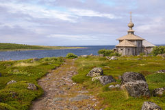 Saint Andrew chapel on Greater Zayatsky island. View of church and stone pass stock photo