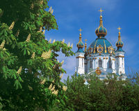 Saint Andrew's Church in Kiev, Ukraine. Saint Andrew's Church in Kiev with flowering chestnut trees in front stock photo