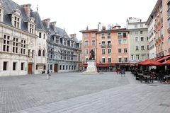 Saint-Andrew square and bronze statue of Chevalier Bayard, Grenoble, France. Grenoble is a city in southeastern France, at the foot of the French Alps where the stock image