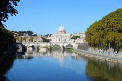 Saint Angel Bridge and St Peters Cathedral. Saint Angel Bridge in Rome and St Peters Cathedral in Vatican Royalty Free Stock Photo