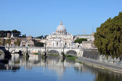 Saint Angel Bridge and St Peters Cathedral. Saint Angel Bridge in Rome and St Peters Cathedral in Vatican Royalty Free Stock Image