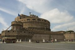 Saint Angelo Castle, Rome, Italy. Castel San Angelo or Saint Angelo Castle, Rome, Italy and tourists around taking a rest stock photo
