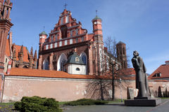 Saint Annes Church and Adam Mickiewicz Monument in Vilnius. Designed by Gediminas Jokūbonis, Lithuanian sculptor. The Bernardine Monastery is nearby Royalty Free Stock Photo
