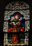 Saint Anthony. Saint Antonius or Saint Anthony, a famous Roman catholic saint on a stained glass window in the cathedral of Spa, Belgium Stock Photos