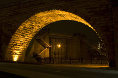 Saint Anthony Falls Lock and Dam at Night. Lock and Dam framed by Stone Arch Bridge at Saint Anthony Falls of the Mississippi River in Minneapolis royalty free stock photography