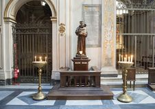 Saint Anthony of Padua with the infant Jesus, offertory in Basilica Saint Maria of Trastevere. Pictured is a statue of Saint Anthony of Padua with the infant Royalty Free Stock Photos
