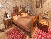 SAINT ANTON, SLOVAKIA - FEBRUARY 27, 2014: Bedroom of guests. Furniture from 19. cent in palace Saint Anton Royalty Free Stock Photo