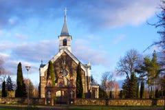 Saint apostles catholic church of stones and fence. Folk architecture Royalty Free Stock Photo