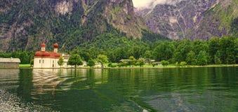 Saint Bartholomew church in Bavaria, Germany. View from Konigssee lake Royalty Free Stock Image