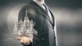Saint Basil`s Cathedral Businessman Holding in Hand Landmark New technologies. Businessman in the future with futuristic technology with landmark stock footage