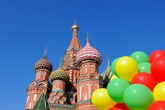 Saint Basil`s Cathedral in Moscow on Red Square. Saint St Basil`s Cathedral in Moscow on Red Square against a blue sky and with a bunch of colorful balloons in Royalty Free Stock Image