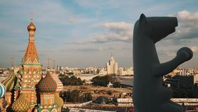 Saint Basil`s Cathedral, Moscow State University and bear statue timelapse stock footage