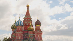 Saint Basil`s Cathedral on the sky background with clouds stock video