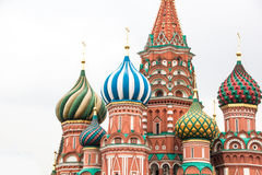 Saint Basils Cathedral on Red Square in Moscow, Russia. Fragment view of Saint Basil`s Cathedral in Moscow on the white background Stock Image