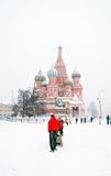 Saint Basils church and Red Square in Moscow at snowstorm. Royalty Free Stock Photos