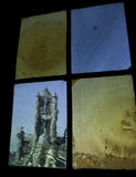 Saint Bavo Cathedral seen across gothic window Stock Images