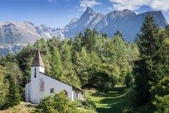 Saint Blasius church, wildlife and alps background. Piburg wild mountainous natural, Oetz, Austria, Europe. Saint Blasius church, wildlife and alps background Stock Images