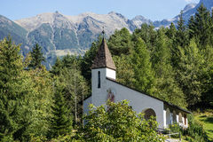 Saint Blasius church, wildlife and alps background. Piburg wild mountainous natural Stock Image