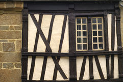 Saint-Brieuc (Brittany): half-timbered house. Saint-Brieuc (Cotes-d'Armor, Brittany, France): old typical half-timbered house a window Stock Image