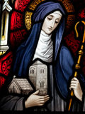 Saint Brigid of Kildare. Stained glass in Catholic church in Dublin showing saint Brigid of Kildare stock photos