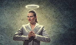 Saint businesswoman Stock Images