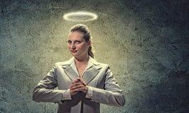 Saint businesswoman Stock Images