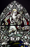 Saint Christopher with baby Jesus on his shoulder (stained glass) Royalty Free Stock Photos