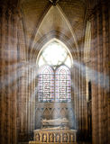 Saint denis cathedral. Sun rays beaming through the old stained glass window of saint denis cathedral and lighting interior with tomb. Paris, France, Europe Royalty Free Stock Photos