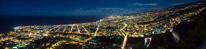 Saint-Denis city an night. Panoramic view of Saint-Denis city illuminated at night, Reunion Island Royalty Free Stock Images