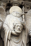 Saint Denis holding his head Royalty Free Stock Photography