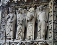 Saint Denis Statue Holding His Head at Notre Dame Cathedral Stock Images