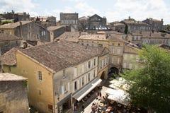 Saint Emilion, Bordeaux / France - 06 19 2018 : Bordeaux wine routes vineyard of saint-emilion unesco town Beautiful cityscape vi. Ew on Saint Emilion village in royalty free stock image
