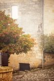 Saint-Emilion in mist. Street in Saint Emilion, Gironde, Aquitaine, France. Toned and vignetted image stock images