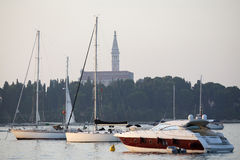Saint Euphemia bell tower and anchored sailboats Royalty Free Stock Photo