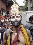 A saint in Festival of Cows( Gaijatra). Gai Jatra (gai means cow and jatra means festival in Nepali) is a festival celebrated by the Newar community, mainly of Stock Photo