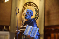 Saint figure with the bible in an catholic church. Empty copy space for Editor`s text Stock Photography