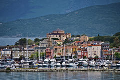 Saint-Florent seen from the port. Saint-Florent dominated by the citadel, seen from the port, Haute-Corse, Corsica Island, France Stock Photos
