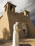 Saint Francis Statue With Church Stock Images