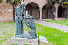 Saint Francis and the wolf Stock Images