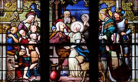 Saint Genevieve giving sight to his mother in the presence of Saint Marcel. Stained glass window in Saint Severin church in Paris, France royalty free stock images