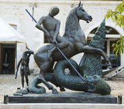 Saint George and the Dragon bronze statue by Salvador Dali at the Court Square inside of Chateau de Pommard winery in Burgundy Stock Image